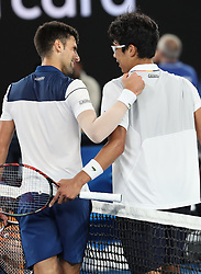 MELBOURNE, Jan. 22, 2018  Chung Hyeon (R) of South Korea and Novak Djokovic of Serbia greet each other after the men's singles fourth round match at Australian Open 2018 in Melbourne, Australia, Jan. 22, 2018. Chung Hyeon won by 3-0. (Credit Image: © Bai Xuefei/Xinhua via ZUMA Wire)