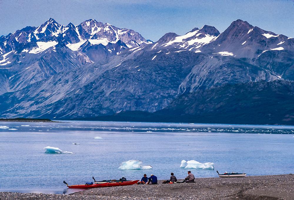 John and Pat Willits, unknown kayaker and Rhan Flatin, Reid Inlet and glacier, Glacier Bay National Park, Alaska. USA