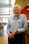 Professor Emeritus of Political Science George Drake poses for a portrait inside the Drake Community Library in Grinnell on Wednesday afternoon.<br /> BEN BREWER/Grinnell College