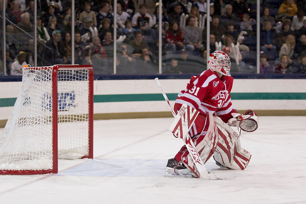 Boston University goaltender Kieran Millan (#31) sets in the crease for a shot in second period action of NCAA hockey game between Notre Dame and Boston University.  The Notre Dame Fighting Irish defeated the Boston University Terriers 5-2 in game at the Compton Family Ice Arena in South Bend, Indiana.