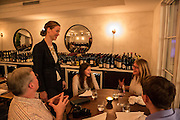 New York, NY, - December 8, 2013. Barbara Lambert talking to diners in the Barrel Room. Lambert and her husband, chef Matt Lambert, are co-owners of The Musket Room, 265 Elizabeth St.