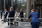 Insurance industry business people gather outside the Lloyds of London building on leadenhall Street in the City of London, the capitals financial district aka the Square Mile, on 10th July 2019, in London England.