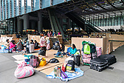 Filipino domestic workers gather on their day-off under the Hong Kong and Shanghai building in central, Hong Kong. Approximately 130,000 Filipino domestic servants work in Hong Kong and all have Sundays off.
