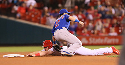 September 28, 2017 - St Louis, MO, USA - St. Louis Cardinals pinch runner Harrison Bader is tagged out by Chicago Cubs second baseman Tommy La Stella while trying to steal second in the 10th inning on Thursday, Sept. 28, 2017, at Busch Stadium in St. Louis. The Cubs won, 2-1. (Credit Image: © Chris Lee/TNS via ZUMA Wire)