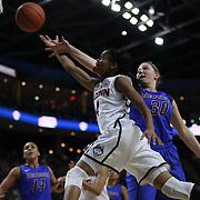 Moriah Jefferson, UConn, drives to the basket past Megan Podkowa, DePaul, during the UConn Vs DePaul, NCAA Women's College basketball game at Webster Bank Arena, Bridgeport, Connecticut, USA. 19th December 2014