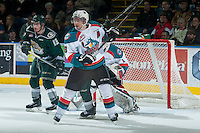 KELOWNA, CANADA - JANUARY 23: Colten Martin #8 of Kelowna Rockets checks a player of the Everett Silvertips on January 23, 2015 at Prospera Place in Kelowna, British Columbia, Canada.  (Photo by Marissa Baecker/Shoot the Breeze)  *** Local Caption *** Colten Martin;