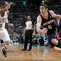 10 May 2012: Atlanta Hawks guard Kirk Hinrich (6) drives past Boston Celtics point guard Rajon Rondo (9) during the Boston Celtics 83-80 victory over the Atlanta Hawks, in Game 6 of the Eastern Conference first-round playoff series, at the TD Banknorth Garden, Boston, Massachusetts, USA.