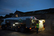 The daily milk collection by Russ Cowton and the Arla collection truck. Arla is a farmer owned international dairy and dairy products cooperative. Home to some of the UK's leading dairy brands, including Cravendale, Anchor, Lurpak and Castello, Arla Foods UK supplies a full range of fresh dairy products to the major retailers and foodservice customers, from its 3000 cooperative farmers across the UK. Wildon Grange Dairy Farm, Coxwold, North Yorkshire, UK. Owned and run by the Banks family, dairy farming here is a scientific business, where nothing is left to chance. From the breeding, nutrition and health of their closed stock of Holstein Friesian cows, through to the end product, the team here work tirelessly, around to clock to ensure content and healthy animals, and excellent quality milk. (photo by Mike Kemp/In Pictures via Getty Images)