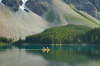 Canoeists paddling on Moraine Lake, Banff National Park Alberta Canada