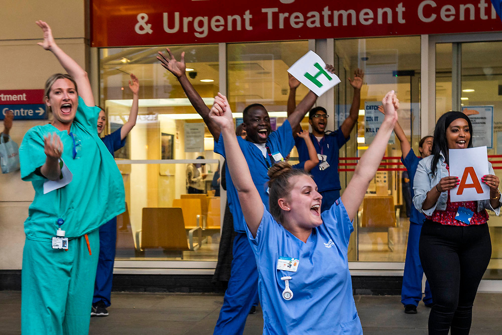 Hospital staff, including the A&E department,  come out of Chelsea and Westminster and are greeted by a small but enthusiastic crowd, including several car loads of Met Police Officers - Clap for carers, to say thanks to NHS and other key workers and carers. The 'lockdown' continues in Clapham - Coronavirus (Covid 19) outbreak in London.