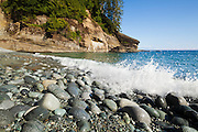 Rounded cobbles, shaped by wave action, pave the beach at Cullite Cove, West Coast Trail, British Columbia, Canada.