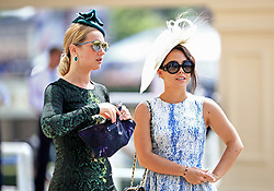 Female racegoers during day two of Royal Ascot at Ascot Racecourse.