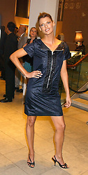 Model LINDA EVANGELISTA at a cocktail party hosted by MAC cosmetics to kick off London Fashion Week at The Hospital, 22 Endell Street London on 18th September 2005.At the event, top model Linda Evangelista presented Ken Livingston the Lord Mayor of London with a cheque for £100,000 in aid of the Loomba Trust that aims to privide education to orphaned children through a natural disaster or through HIV/AIDS.<br /><br />NON EXCLUSIVE - WORLD RIGHTS