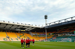 Charlton Athletic players inspect the pitch prior to the match