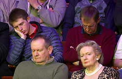 Snooker fans fall asleep during day three of the 2018 Betfred World Championship at The Crucible, Sheffield.