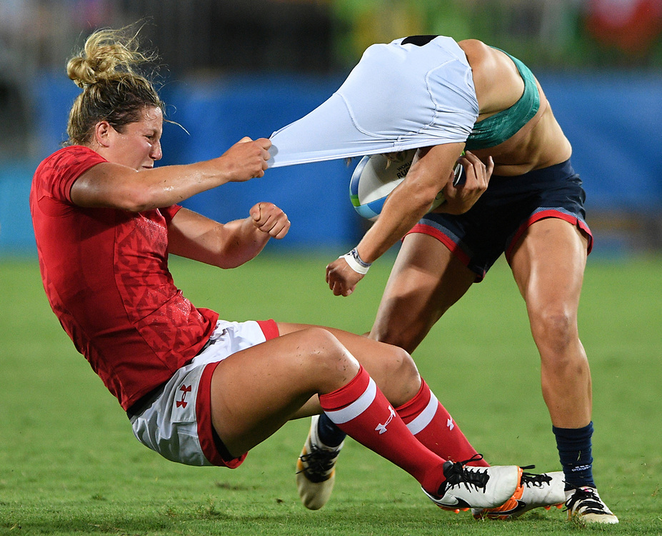 Canada's Kelly Russell rips the shirt off of  Great Britain's Katy McLean as she tackles her during the bronze medal match in women's rugby sevens at the 2016 Olympic Summer Games in Rio de Janeiro, Brazil on Monday, Aug. 8, 2016. THE CANADIAN PRESS/Sean Kilpatrick