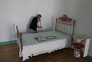 A woman cleans a  Jose Saramago's bedroom recreation in the museum house on his birth place Aldeia da Azinhaga, central Portugal . Portuguese Nobel Prize of Literature, Jose Saramago, died at his house in Lanzarote on June 18. PAULO CUNHA/4SEEPHOTO