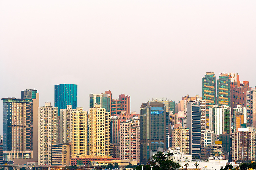 Skyline of tall residential skyscrapers of apartments in Hong Kong.