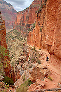 Hiking on the North Kaibab trail through the Redwall layer of Grand Canyon