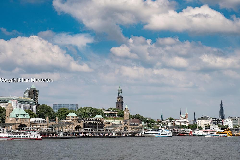 View of boat landing jetties, Landungsbrucken and skyline of city at St Pauli in port of Hamburg Germany