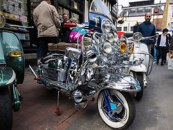 London, May 2nd 2015. Scores of scooter fanatics assemble in Carnaby Street for the annual Buckingham Palace Scooter Run that started life in the early eighties and was resurrected a few years ago by the New Untouchables and Bar Italia Scooter Club, with the run taking in many of the tourist hotspots in the capital before heading down the Mall towards Buckingham Palace.