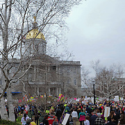 Crowds gather on the NH State House lawn to protest the proposed state budget.