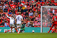 AFC Flyde forward Alex Reid (30) shoots towards the goal during the FA Trophy final match between AFC Flyde and Leyton Orient at Wembley Stadium on 19 May 2019.