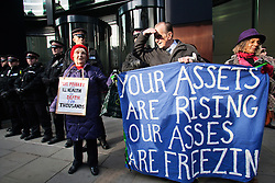 © Licensed to London News Pictures. 26/11/2013. London, United Kingdom. People gather to protest against the increase of energy bills outside the NPower headquarter. 31000 people have died the last year due to the cold because they couldn't have afforded to pay the heating bills.  Photo credit : Andrea Baldo/LNP