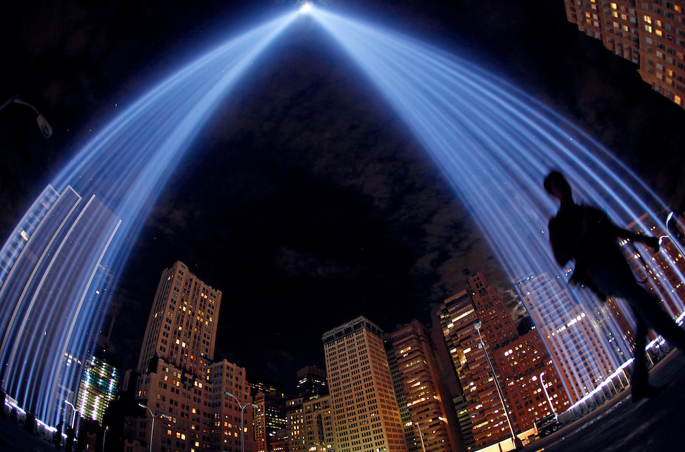 """The """"Tribute in Lights"""" are seen over the skyline in New York, September 10, 2011. National and city leaders will commemorate on Sunday the ten-year anniversary of the attacks of 9/11 with a ceremony unveiling a memorial and museum.  REUTERS/Jim Young"""