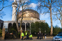Regent's Park Mosque, London, February 27th 2015. A small group of Islamic Radicals demonstrate after Friday prayers, calling for the release of Islamist Sheikh Omar Bakri Muhammad from prison in Lebanon's Roumeih prison. They say he is unwell and has suffered torture. PICTURED: After mitigating the risk of a far-right counter protest, police leave Regents Park Mosque.