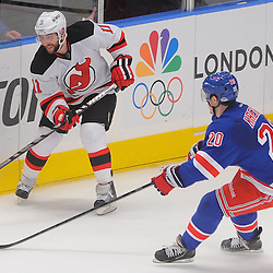 May 16, 2012: New Jersey Devils right wing Stephen Gionta (11) flips the puck out of the zone and away from New York Rangers left wing Chris Kreider (20) during second period action in game 2 of the NHL Eastern Conference Finals between the New Jersey Devils and New York Rangers at Madison Square Garden in New York, N.Y.
