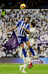 MADRID, Feb. 4, 2019  Alaves' Manu Garcia (L) vies for ball during a Spanish La Liga match between Real Madrid and Alaves in Madrid, Spain, on Feb. 3, 2019. Real Madrid won 3-0. (Credit Image: © Edward F. Peters/Xinhua via ZUMA Wire)