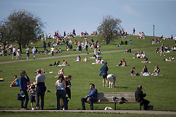 © Licensed to London News Pictures.30/03/2021. Brighton,UK. Members of the public enjoy spring weather in Primrose Hill, north London. Temperatures are expected to rise with highs of 23 degrees forecasted for parts of London and South East England today . Photo credit: Marcin Nowak/LNP