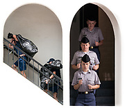 At left, knobs in Bravo company carry their sized uniform pieces up the stairs on Matriculation Day, Saturday, August 14, 2021. At right, two days later, knobs in Golf company drive stairs prior to taking the Cadet Oath on Monday, August 16, 2021.<br /> <br /> Credit: Cameron Pollack / The Citadel