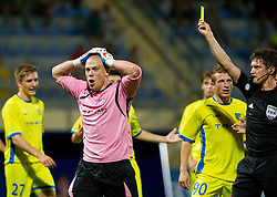 Nejc Vidmar #41 of Domzale swith yellow card by referee Matej Jug during football match between NK Domzale and NK Zavrc in 5th Round of Prva liga Telekom Slovenije 2013/14 on August 10, 2013 in Sports park Domzale, Slovenia. (Photo by Vid Ponikvar / Sportida.com)