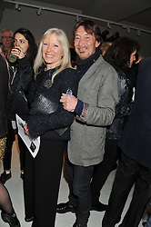 CHRIS REA and his wife JOAN at a private view of Bill Wyman - Reworked held at the Rook & Raven Gallery, 7 Rathbone Place, London W1 on 26th February 2013.