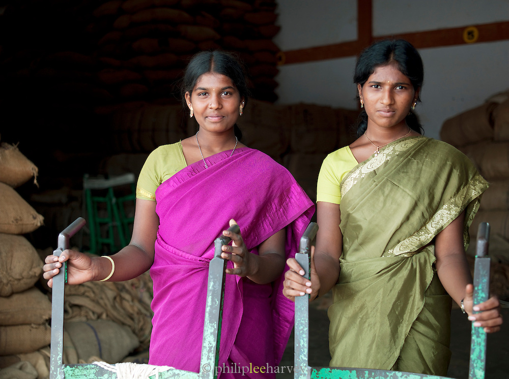 Coffee plantation workers with sack barrows, Malabar, Kerala, India.