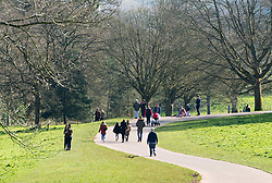 © Licensed to London News Pictures; 22/03/2020; Bristol, UK. Coronavirus Pandemic; people enjoy a walk in the open air at Ashton Court estate park on a sunny weekend, after the UK's prime minister ordered the closure of all pubs, bars, cafes, restaurants and indoor gyms to try and prevent the spread of the coronavirus. The UK Government is urging people to maintain social distance but also to get fresh air and exercise outside with social distance between people. Photo credit: Simon Chapman/LNP.