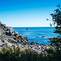 Hardy Boat ferry approaches Monhegan Island.  View from hiking trail on the southeast side.