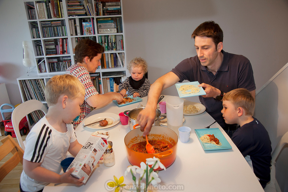 Ottersland Dahl family, of Gjettum, Norway (outside Oslo). At evening meal: Gunhild Valle Ottersland, 45, her husband Tor Erik Dahn, 39, and their three children, Olav, 6 Hakon, 3, and Sverre, 1.5 of Gjettum, Norway, with their typical week's worth of food in June. Food expenditure for one week: 2211.97 Norwegian Kroner; $379.41 USD. Model-Released.