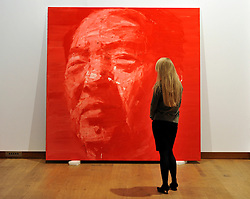 ©London News pictures. 08.02.2011. A woman stands in front ofA portrait of Moa by Yan Pei-Ming entitled Grand Timonier. A preview, today (Fri) of Christie's Auction House Post-War and Contemporary Art Evening Auction. The sale is expected to make a combined total of £46,246,000 to £66,447,000 when it is sold on 16th Feb 2011.. Picture Credit should read Stephen Simpson/LNP