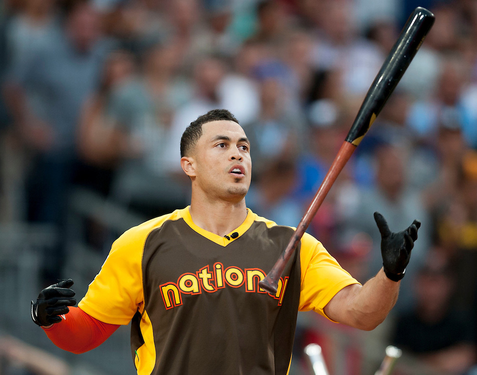 The Marlins' Giancarlo Stanton catches his bat enroute to winning the 2016 Home Run Derby at Petco Park in San Diego on Monday.<br /> <br /> ///ADDITIONAL INFO:   <br /> <br /> derby.0712.kjs  ---  Photo by KEVIN SULLIVAN / Orange County Register  -- 7/11/16<br /> <br /> The 206 MLB All-Star Game at Petco Park in San Diego. <br /> <br /> Villa Park native and former Angel Mark Trumbo competes in the Home-run Derby.