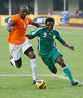 Photo: Steve Bond/Richard Lane Photography.<br />Nigeria v Ivory Coast. Africa Cup of Nations. 21/01/2008. Obafemi Martins (R) tries to go outside Salomon Kalou (L)