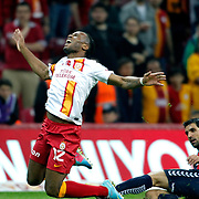 Galatasaray's Tebily Didier Yves Drogba (L) during their Turkish Superleague soccer match Galatasaray between Mersin Idman Yurdu at the AliSamiYen Spor Kompleksi at Aslantepe in Istanbul Turkey on Saturday 06 April 2013. Photo by Aykut AKICI/TURKPIX
