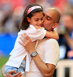 """Manchester City manager Josep Guardiola celebrates with his daughter Valentina Guardiola after the Community Shield match at Wembley Stadium, London. PRESS ASSOCIATION Photo. Picture date: Sunday August 5, 2018. See PA story SOCCER Community Shield. Photo credit should read: Mike Egerton/PA Wire. RESTRICTIONS: EDITORIAL USE ONLY No use with unauthorised audio, video, data, fixture lists, club/league logos or """"live"""" services. Online in-match use limited to 75 images, no video emulation. No use in betting, games or single club/league/player publications."""