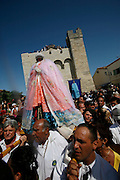 The statue of Saint Sara is carried by Gitan pilgrims outside the church during the Gypsy Pilgrimmage of Saintes Maries de la Mer<br /><br />Europe, France, Camargue, Saintes Maries de la Mer, Gypsy Pilgrimmage 'Pelerinage des Gitans aux Saintes Maries de la Mer'. Gypsies from all over the world come to celebrate their patron Saint Sara who is carried by them from the church to the sea-shore. May 24th and 25th every year