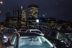 London, UK. 4th February, 2019. Hundreds of Uber minicabs block London Bridge as part of a protest organised by the United Private Hire Drivers (UPHD) branch of the Independent Workers Union of Great Britain's (IWGB)  following the introduction in December of congestion charges for minicabs.