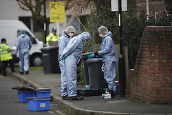 © Licensed to London News Pictures. 04/12/2017. London, UK. Police at the scene of a double murder in Deptford, East London where the bodies of a man believed to be in his 60s and a woman believed to be in her 40s were discovered. Photo credit: Peter Macdiarmid/LNP