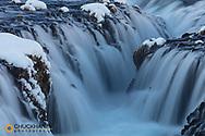 Bruarafoss waterfall in winter in southwestern Iceland