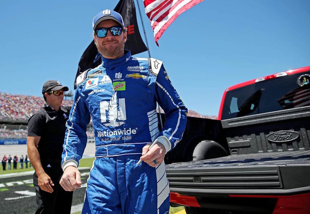 May 7, 2017; Talladega, AL, USA; NASCAR Cup Series driver Dale Earnhardt Jr. (88) get out of a truck on the grid before the GEICO 500 at Talladega Superspeedway. Mandatory Credit: Peter Casey-USA TODAY Sports